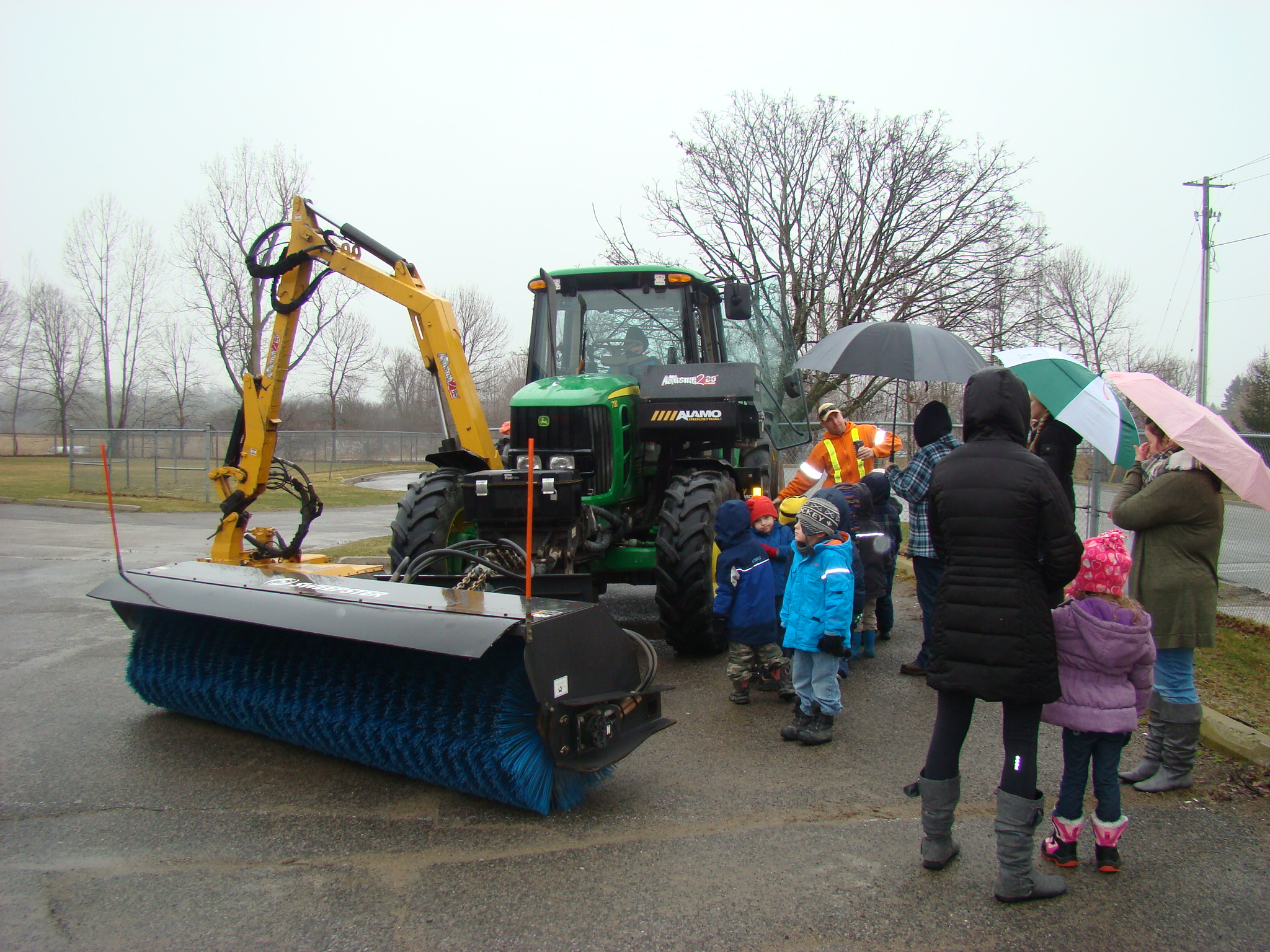 Tractor with mower and street sweeper