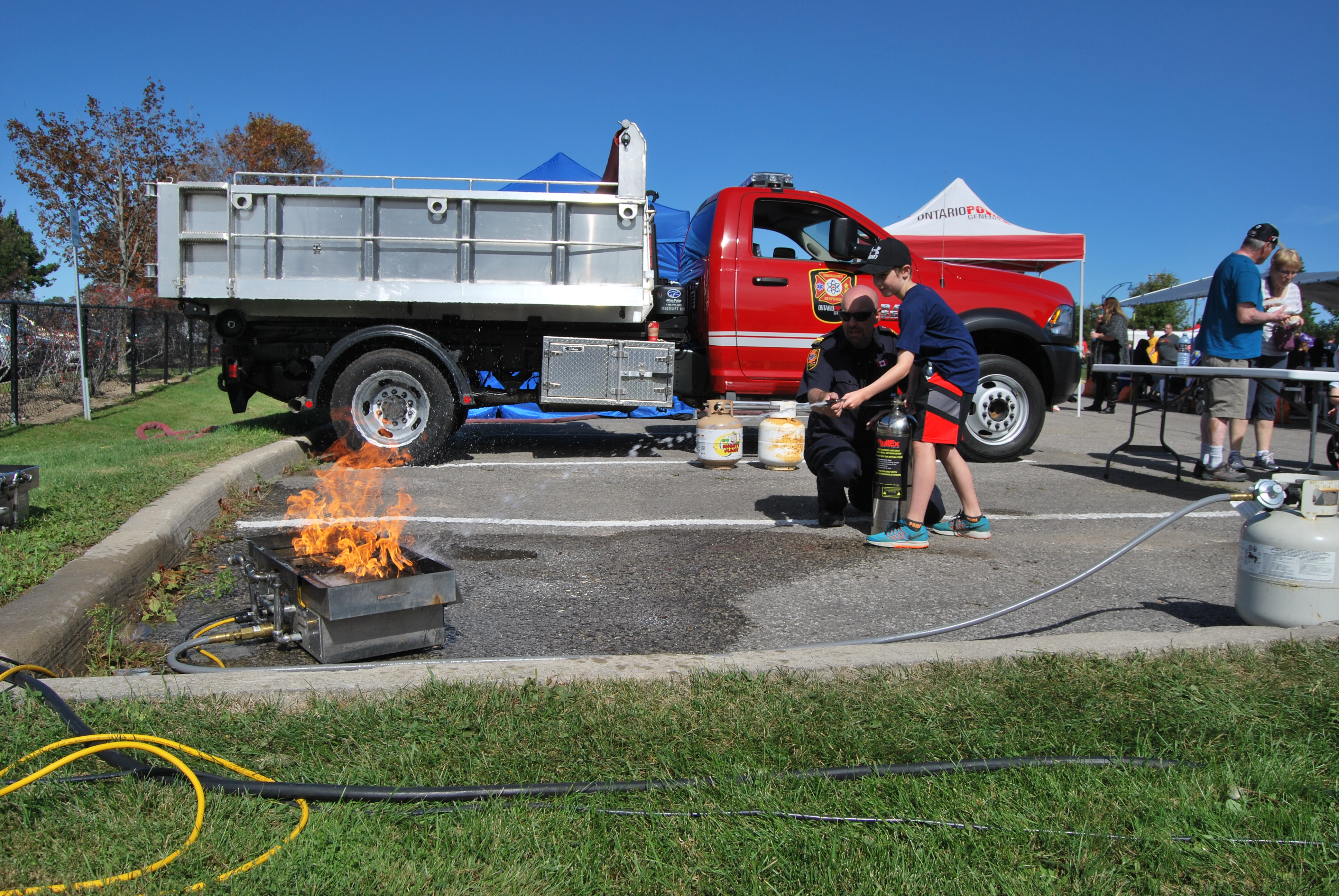 Carson puts out a fire at the Ontario Power Generation booth at Family Safety Day 2015