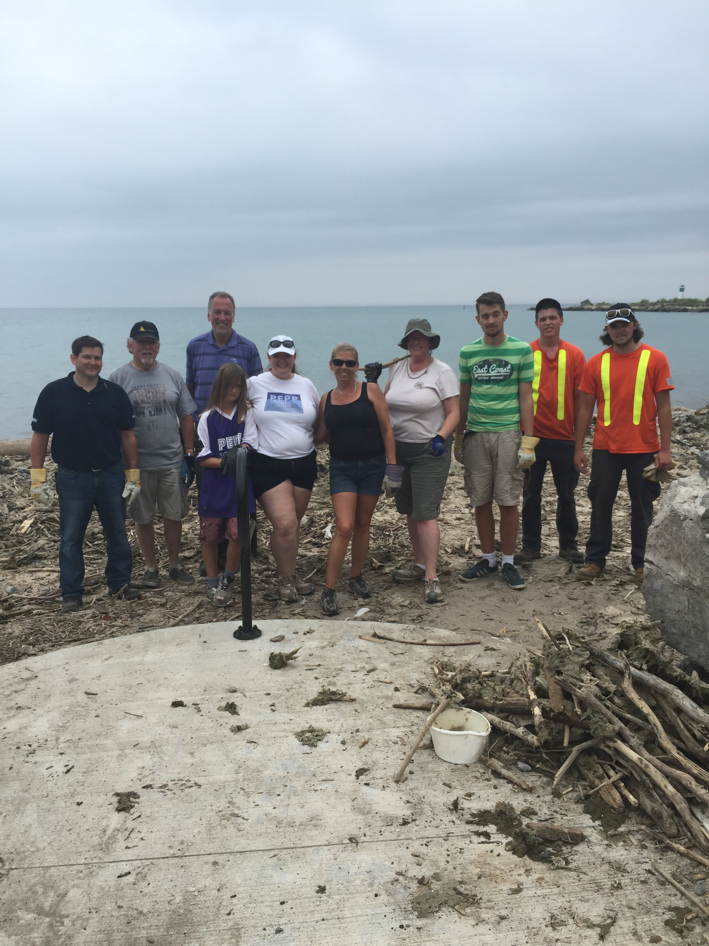 Volunteers and Staff Cleaning Up East Beach